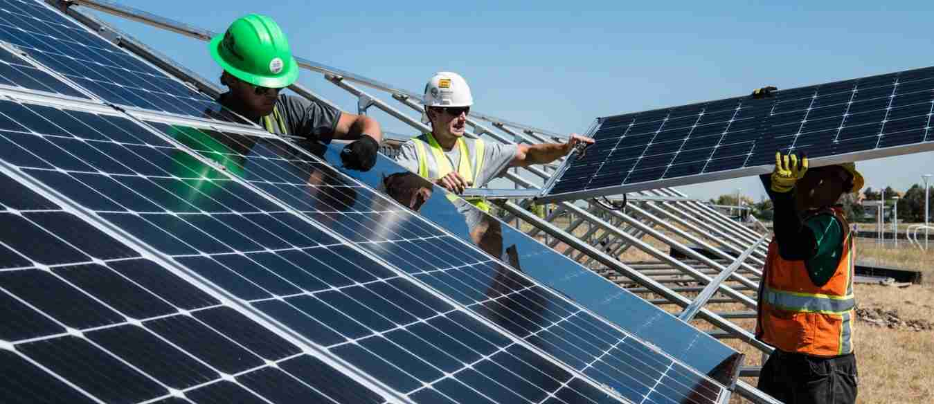 Workers at Solar Farm Installation